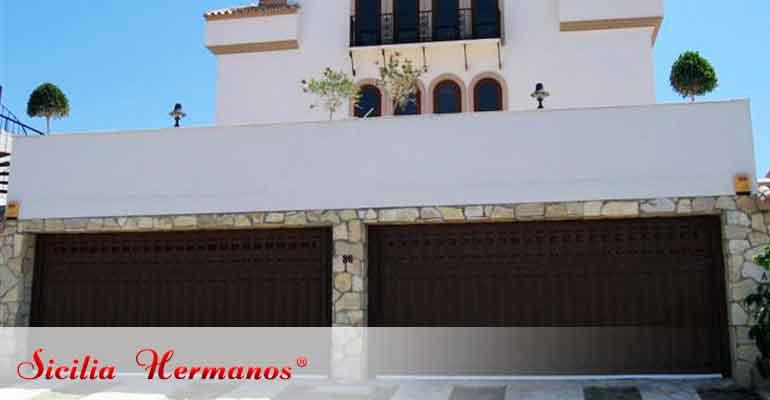 Servicios reparacion puertas de garaje sicilia hermanos for Puertas abatibles garaje